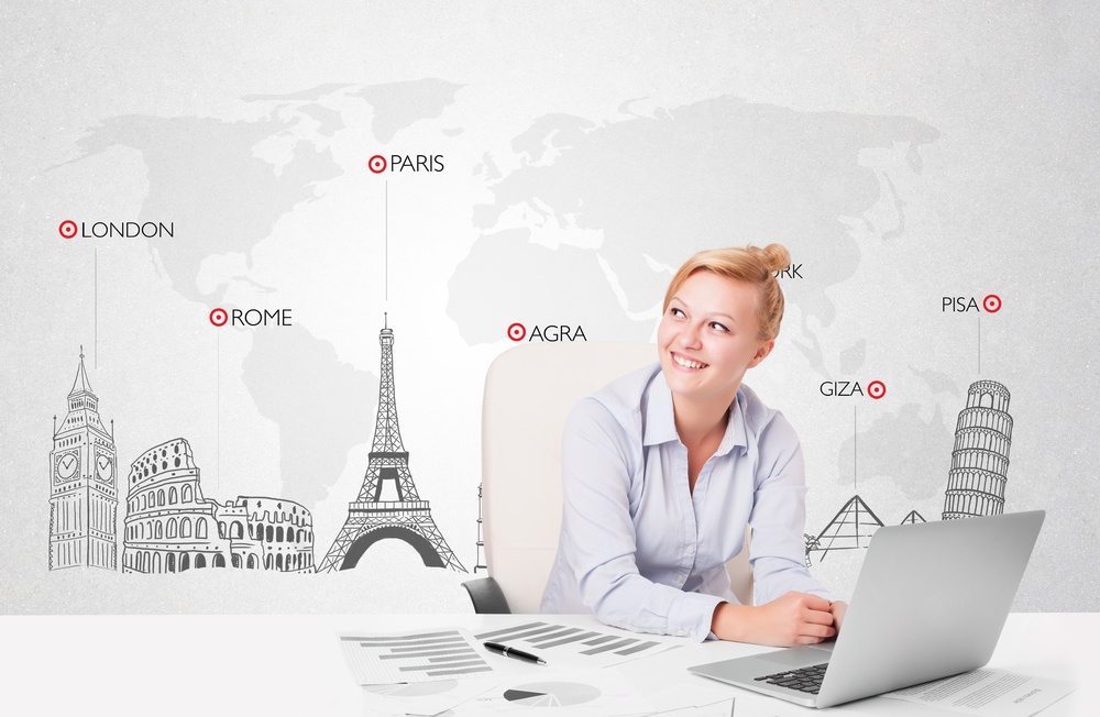 Beautiful young businesswoman with world map and major landmarks of the world.jpeg